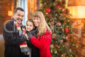 Young Mixed Race Family Portrait In Front of Christmas Tree Indo