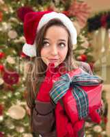 Thinking Girl Wearing A Christmas Santa Hat with Bow Wrapped Gif
