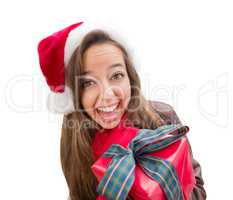 Girl Wearing A Christmas Santa Hat with Bow Wrapped Gift Iisolat