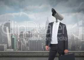 Businessman with CCTV head with city skyline