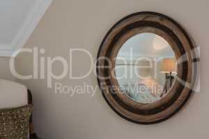 Wooden framed mirror on wall