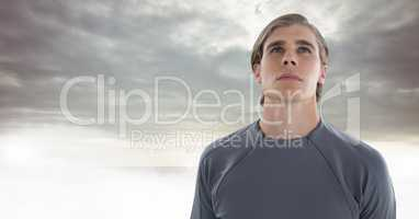 Man looking up with clouds background