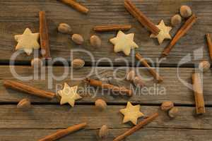 Star shape cookies and cinnamon sticks with walnuts