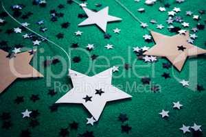 Handmade stars on green background