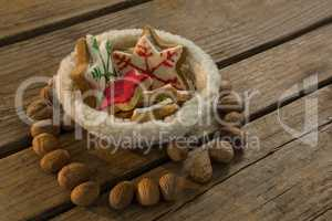 High angle view of star shape cookies in bowl amidst walnuts
