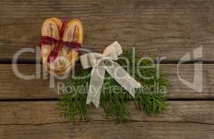 Overhead view sweet food with tied bow and pine needles on table