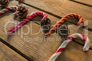 Colorful candy canes with pine cones