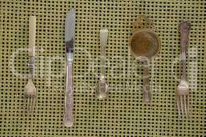 Spoons, fork, butter knife and strainer