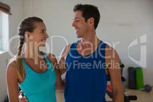Happy athletes looking at each other in gym