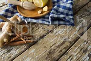 High angle view of various food with checked napkin on weathered table