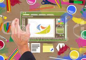 Hand touching Graphic design editor window and creative art objects on Paper cut out desktop