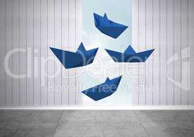 Blue paper boats floating in room