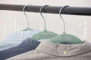 Close-up of shirts hanging on hanger