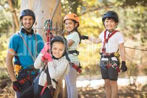 Kids enjoying zip line adventure on sunny day