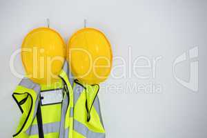 Close-up of protective workwear hanging on hook