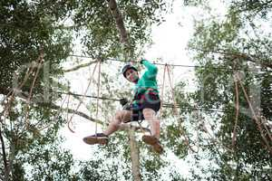 Man enjoying zip line adventure in park