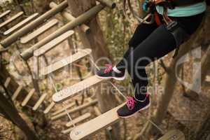 Woman on zipline in adventure park
