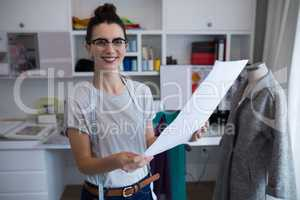 Fashion designer holding a document