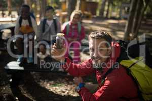 Portrait of teacher experimenting soil in park