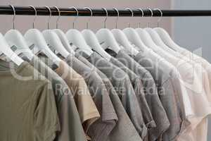 Various t-shirts hanging on cloth hanger