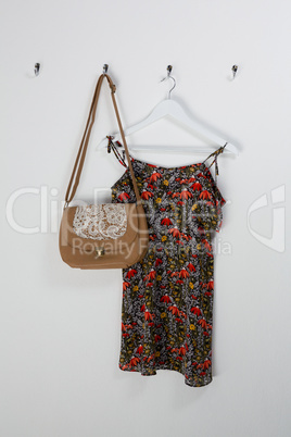 Dress and bag hanging on hook