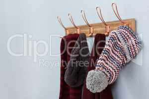 Warm clothings hanging on hook