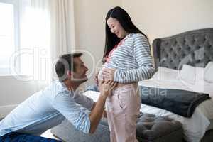 Happy man feeling the presence of baby