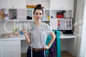 Fashion designer standing with hand on hip
