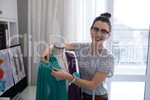 Fashion designer designing a fabric textile