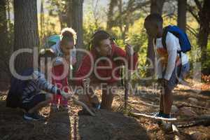 Teacher and kids examining soil