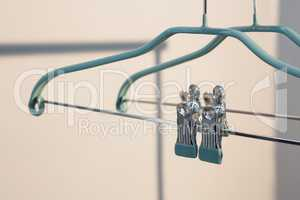 Empty cloth hanger with clothes peg