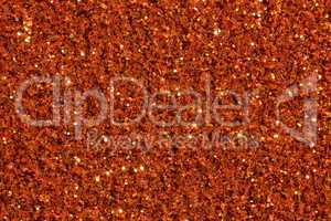 Saturated brick-colour background with glitter.