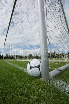 Soccer ball near a goal post