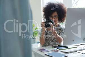 Graphic designer taking picture with digital camera