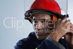 Fireman adjusting his safety helmet