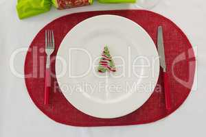 Plate and cutlery set beautifully on Christmas theme