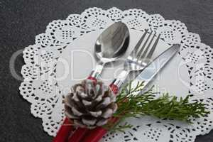 Pine cone with cutlery on a placemat