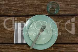Plate with fork, napkin and glass