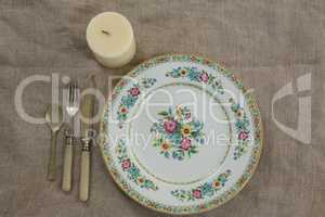 Floral pattern plate with cutlery set and candle