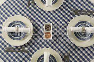 Rolled up napkin arranged on plate
