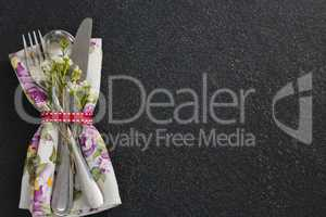 Cutlery with flower and napkin tied with ribbon
