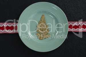 Christmas ornament in a plate with ribbon