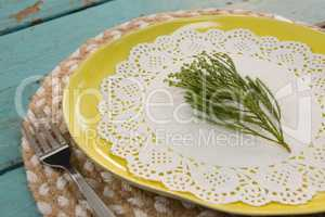 Table setting on wooden plank