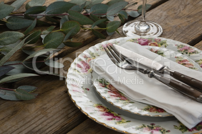 Floral pattern plate with cutlery set and leaf