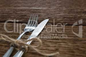 Fork and butter knife tied up with a rope