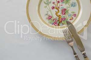 Fork, butter knife, spoon in a plate