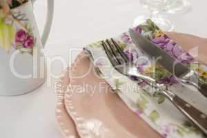 Fork, butter knife and napkin in a plate