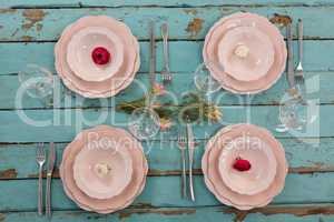 Elegance table setting on weathered wooden plank