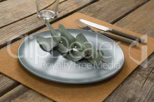 Elegant table setting with leaf and cutlery