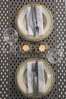 Elegance table setting with wine glasses on placemat